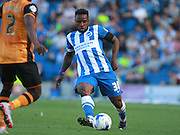 Brighton midfielder winger Kazenga LuaLua plays the ball down the line during the Sky Bet Championship match between Brighton and Hove Albion and Hull City at the American Express Community Stadium, Brighton and Hove, England on 12 September 2015. Photo by Bennett Dean.
