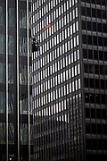 Window washers work a facade on a high rise on Park Avenue in midtown,