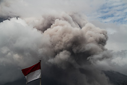 November 13, 2016 - Karo, North Sumatra, Indonesia - Bursts of volcanic ash flowing from Sinabung volcano during eruption seen from the village of Simpang Empat, Karo, North Sumatra, on November, 12, 2016. Activities Sinabung since last week continued to show improvement so that people and tourists are encouraged to not move in a radius of 3-5 km. (Credit Image: © Ivan Damanik via ZUMA Wire)