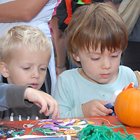 Jack Henry, 4, (left) and Max Mooney, 3, doctorate their pumpkins during the Santa Monica Main Street Farmers Market on Sunday, October 24, 2010.