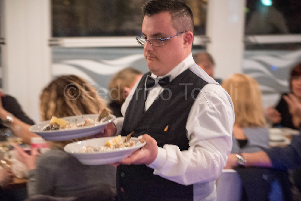 Paul serving a meal during the evening shift