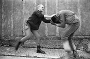 Felix and Lee Hill fun fight, High Wycombe, UK, 1980s.