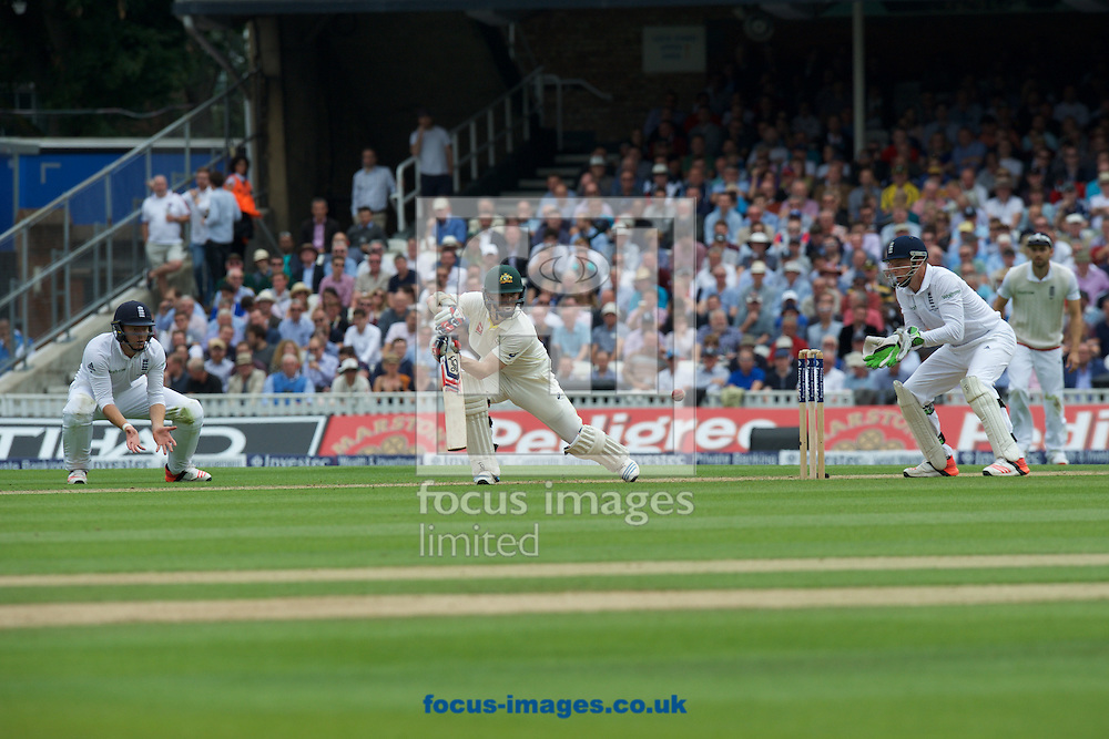 Chris Rogers of Australia hits a four during the 5th Investec Ashes Test Match match at the Kia Oval, London<br /> Picture by Alan Stanford/Focus Images Ltd +44 7915 056117<br /> 20/08/2015