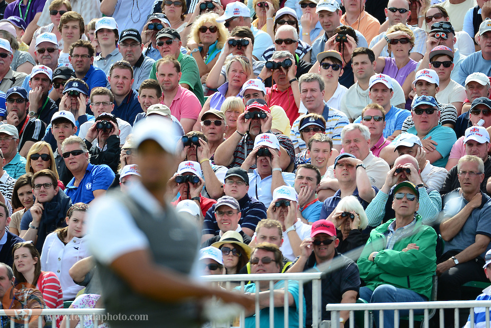 July 21, 2012; St. Annes, ENGLAND; Spectators watch as Tiger Woods hit his tee shot on the 5th hole during the third round of the 2012 British Open Championship at Royal Lytham & St. Annes Golf Club.