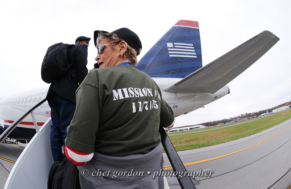 WWII Veterans and their escorts during the sendoff ceremony for the Hudson Valley Honor Flight #10 at Westchester County Airport in White Plains, NY on Saturday, November 7, 2015. Sixty-four veterans from the Westchester County (NY) area toured the WWII and Marine Corps War Memorials, as well as Arlington National Cemetery. Hudson Valley Honor Flight is a chapter of the Honor Flight Network, which provides free flights for WWII Veterans and tours of the WWII Memorial constructed in their honor, and other sites in the nation's capital.  © Chet Gordon / Hudson Valley Honor Flight