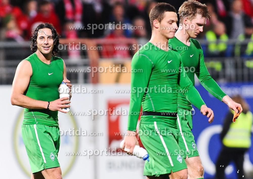 05.02.2011, Bruchwegstadion, Mainz, GER, 1. FBL, FSV Mainz 05 vs Werder Bremen, im Bild Claudio Pizarro (Bremen #24), Marko Arnautovic (Bremen #7) und Per Mertesacker (Bremen #29) nach dem Spiel, EXPA Pictures © 2011, PhotoCredit: EXPA/ nph/  Roth       ****** out of GER / SWE / CRO  / BEL ******