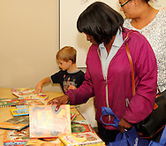(from left) Andrew Montavon, 5 of Centerville, Wanda McNeal of Dayton and Mariesa Thomas of Dayton in the Project Read room during the 10th Annual Celebrating life & health free community health fair at Sinclair's Ponitz Center in downtown Dayton, Saturday, April 21, 2012. In the Project Read room, vistors can pick up childrens books to take home.
