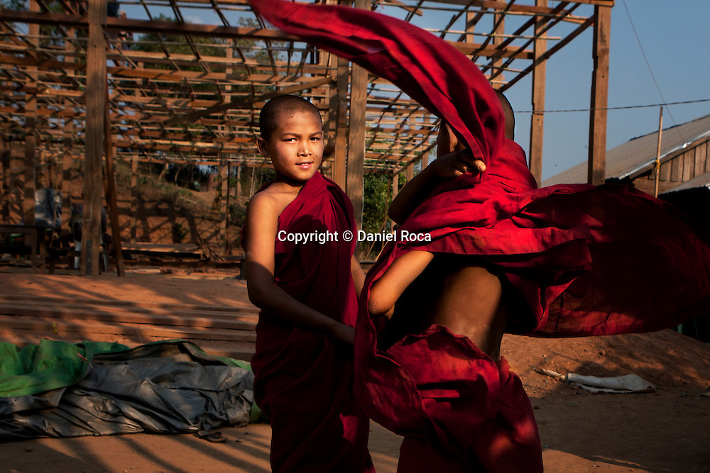 Young monks playing. Myanmar.
