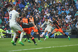 April 29, 2017 - Madrid, Spain - MADRID, SPAIN. APRIL 29th, 2017 - Cristiano Ronaldo shoots on goal. La Liga Santander matchday 35 game. Real Madrid defeated 2-1 Valencia with goals scored by Cristiano Ronaldo (26th minute) and Marcelo (86th minute). Parejo (82nd minute) scored for Valencia. Santiago Bernabeu Stadium. Photo by Antonio Pozo | PHOTO MEDIA EXPRESS (Credit Image: © Antonio Pozo/VW Pics via ZUMA Wire/ZUMAPRESS.com)