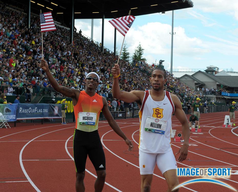 Jun 24, 2012; Eugene, OR, USA; Tony McQuay (left) and Bryshon Nellum fo Southern California take a victory lap with United States flags after placing second and third in the 400m in the 2012 U.S. Olympic Team Trials at Hayward Field.