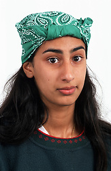 Portrait of teenage girl with long hair wearing head scarf,