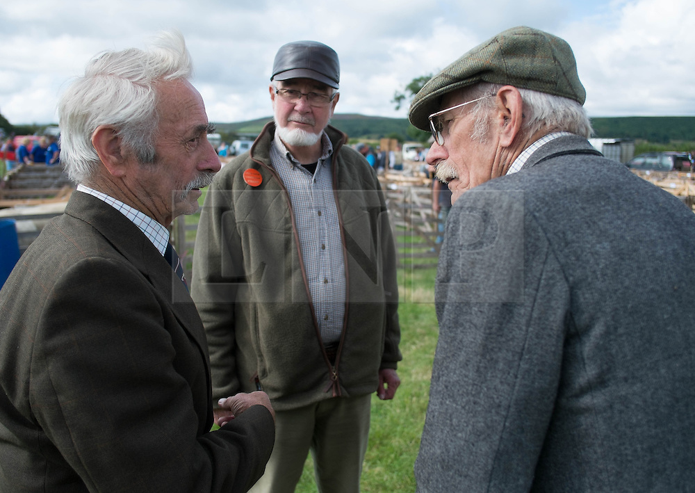 © Licensed to London News Pictures. <br /> 13/08/2014. <br /> <br /> Danby, North Yorkshire, United Kingdom<br /> <br /> Stewards in discussion during the Danby Agricultural Show in North Yorkshire. <br /> <br /> This year is the 154th show which was founded in 1848. It is the oldest agricultural show in the area and offers sheep dog trials, judging of a variety of different animals such as cattle, sheep, ferrets, horses and rabbits along with different classes of horticulture and dairy. <br /> <br /> Photo credit : Ian Forsyth/LNP