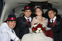 Bride, groom and best men in limousine