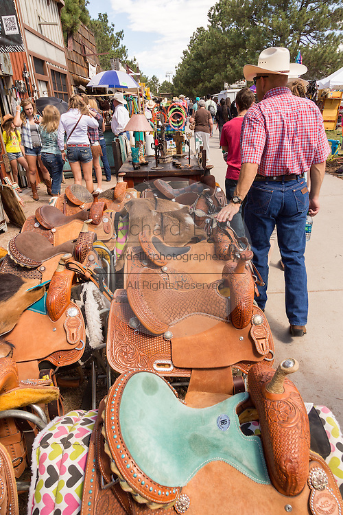 Shops carrying a wide variety of western horse saddles during Cheyenne Frontier Days July 25, 2015 in Cheyenne, Wyoming. Frontier Days celebrates the cowboy traditions of the west with a rodeo, parade and fair.