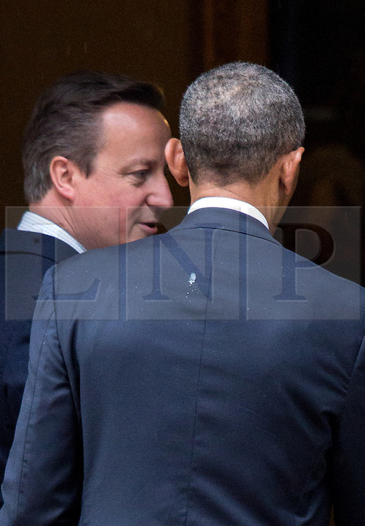 © Licensed to London News Pictures. 22/04/2016. London, UK. US President Barack Obama appears to have bird poo on his back as he visits 10 Downing Street for a joint press conference with British Prime Minister David Cameron. Obama is expected to make his case for the UK to remain inside the European Union, as part of his four day tour to the UK. Photo credit : Tom Nicholson/LNP