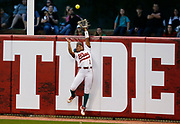 Alabama centerfielder Elissa Brown leaps high to steal a home run away from Mississippi State in Rhoads Stadium Friday, March 29, 2019. [Staff Photo/Gary Cosby Jr.]