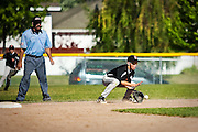 Zach Hillman of Post Falls fields a grounder at second base during Sunday's Little League Championship game at Canfield Athletic Facility.