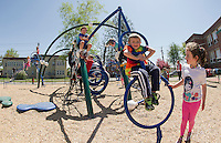 Holy Trinity Pre K and Kindergarten students enjoy active play time during recess in their playground area off Messer Street Thursday afternoon.  (Karen Bobotas/for the Laconia Daily Sun)