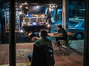 28 JANUARY 2016 - BANGKOK, THAILAND:   SoulBar, a popular bar on Chareon Krung Road in the Chinatown section of Bangkok, does not have a kitchen, but a food truck serving American food, like hamburgers, and Tex-Mex favorites like burritos, parks in front of the bar.       PHOTO BY JACK KURTZ