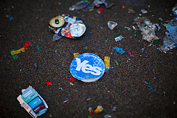 © Licensed to London News Pictures. 19/09/2014. Glasgow, UK. A 'Yes' sticker and rubbish left by disappointed 'Yes' voters and campaigners as Scotland decided to stay in the union, at George Square in Glasgow on Friday, 19 September 2014, after the Scottish independence referendum. Photo credit : Tolga Akmen/LNP
