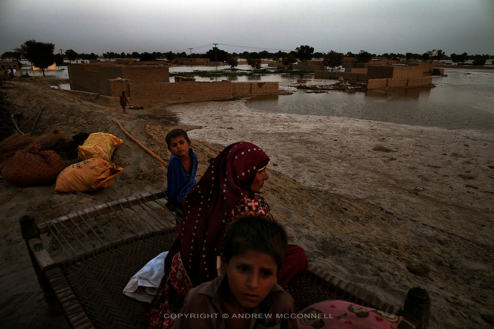A family moves their possessions to higher ground as flood water inundates their village after Manchar Lake burst its banks, near Sehwan, Sindh province, Pakistan.