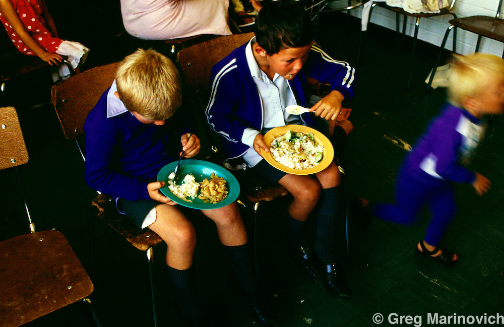 Johannesburg, South Africa 24 March 1994. Poor families of all races get fed at a soup kitchen
