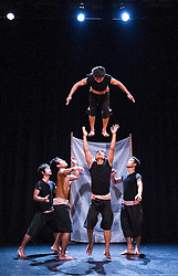 © Licensed to London News Pictures. 25/07/2012. A collaboration between Cambodian circus school Phare Ponleu Selpak and French dance company Compagnie UBI, Rouge features a cast of exceptional young male performers and a two-piece gamelan band. Photo credit : Tony Nandi/LNP