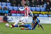 Stoke City midfielder Thomas Ince (7) is tackled by 42 Anthony Grant for Shrewsbury Town during the The FA Cup 3rd round match between Shrewsbury Town and Stoke City at Greenhous Meadow, Shrewsbury, England on 5 January 2019.