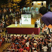 The audience watches dancers compete on stage as part of the celebrations next to main square for the Queen of the Maya 2011 Festival in downtown Valladolid, a colonial town in the heart of Mexico's Yucatan Peninsula.