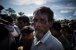 In a refugee camp,Teknaf, Bangladesh. Rohingya refugees waiting in line for food supplies. <br />