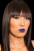 Young woman with vibrant blue lipstick