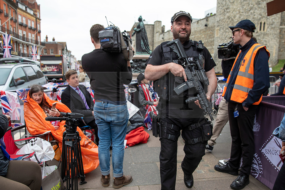 © Licensed to London News Pictures. 16/05/2018. Windsor, UK. Armed police on patrol in Windsor ahead of the Royal Wedding. Prince Harry and Meghan Markle are to be married on Saturday in Windsor. Photo credit: Rob Pinney/LNP