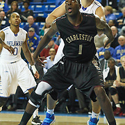 College of Charleston Forward Adjehi Baru (1) boxes out Delaware Forward Carl Baptiste (33) in the paint in the first half of a NCAA regular season Colonial Athletic Association conference game between Delaware and The College of Charleston Wednesday, Feb 5, 2014 at The Bob Carpenter Sports Convocation Center in Newark Delaware.