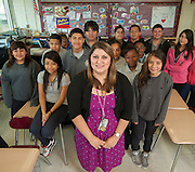 Vanessa Saldaña poses for a photograph with her 7th grade math class at McReynolds Middle School, April 26, 2013.