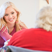 February 11, 2010 - Bronx, NY : Kristen Dalton (pictured), Stefania Fernandez and Stormi Henley--Miss USA, Miss Universe and Miss Teen USA respectively--visited with residents at Schervier Nursing Care Center on Feb. 11.  Schervier resident Anna Kavanagh, 77, chats with Miss USA Kristen Dalton, left, on Feb. 11.