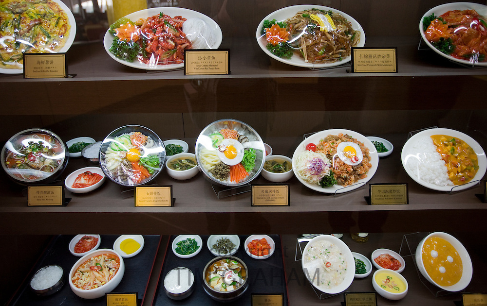 Plates of food on display in a Terminal Three restaurant of Beijing Capital International Airport, China