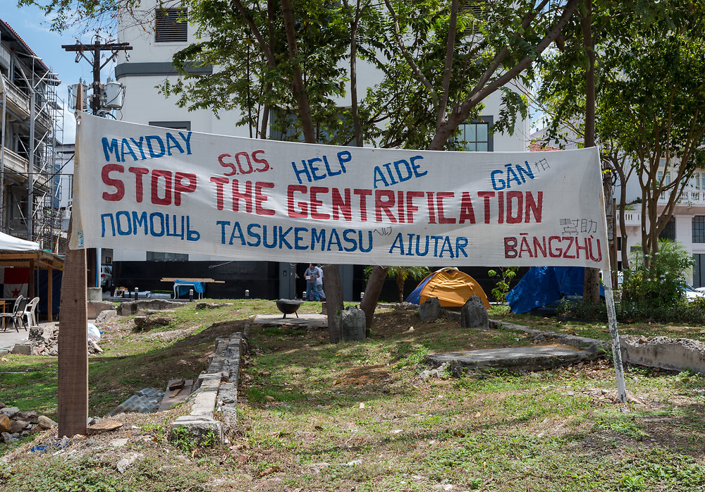Panama City, Panama--April 19, 2018. A protest sign decries gentrification in Panama City. Editorial use only.