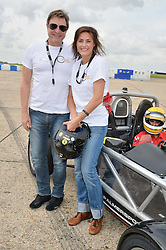 SIMON & YASMIN LE BON at the Stride Foundation Track Day held at the bedford Autodrome, Bedford on 1st August 2014.