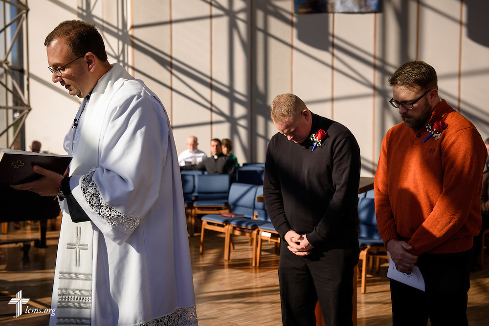 The Rev. Bart Day, executive director of Office of National Mission, prays with the two new national missionaries, the Rev. Peter M. Burfeind (rear, left) and the Rev. Adam DeGroot, during a Service of Sending at the International Center chapel of The Lutheran Church–Missouri Synod on Tuesday, Jan. 12, 2016, in Kirkwood, Mo. LCMS Communications/Frank Kohn