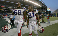 Buffalo Bills offensive tackle Mike Williams(68) walks of the field with teammate Willis McGahee(21) after defeating the Seattle Seahawksat Qwest Field in Seattle, November 28, 2004.