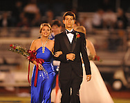 Sophomore maid Isabella Moak (left) is escorted by Brooks Krause during Homecoming of the Oxford vs. Hernando in Oxford, Miss. on Friday, October 14, 2011. Hernando won 31-30 in overtime.