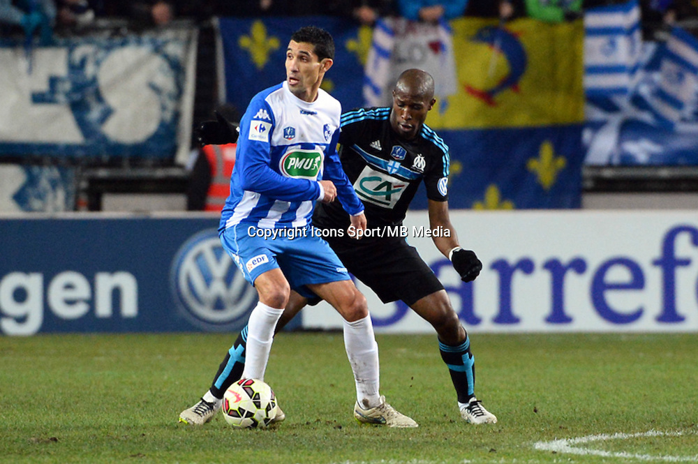Nassim AKROUR / Rod FANNI - 04.01.2015 -  Grenoble / Marseille - Coupe de France<br />Photo : Gaston Petrelli  / Icon Sport