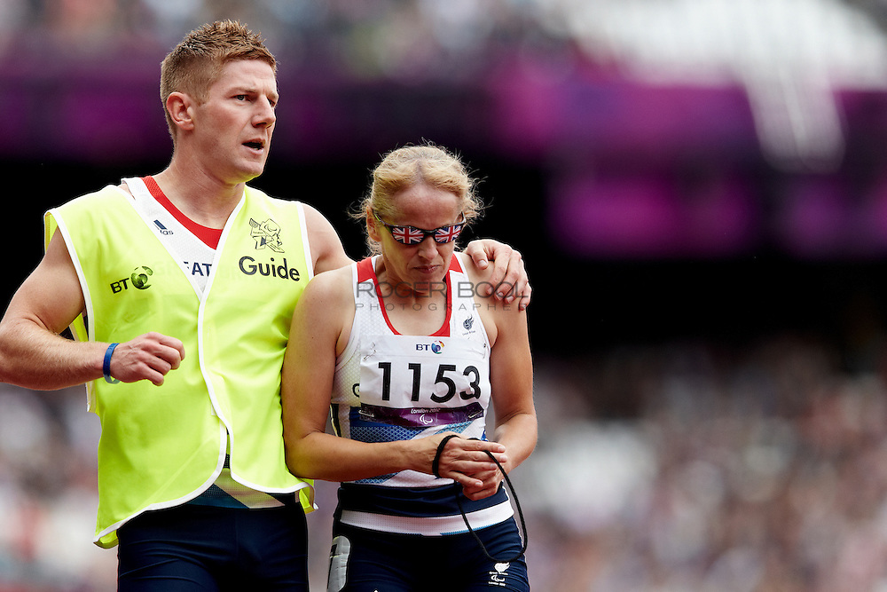 Tracey Hinton and Guide Steffan Hughes of Great Britain in the women's 200 meter T11 semifinals at the Olympic Stadium on day 4 of the London 2012 Paralympic Games. 2nd September 2012.