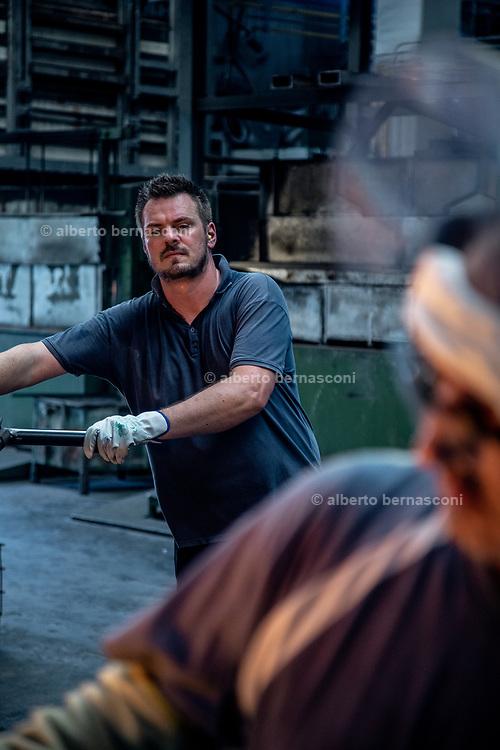 Italy, Resana, Veneto: glass blowers at Nuova Vetreria Resanese, producing for Pulpo designers