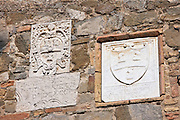 Tiles at the Old City Hall celebrating each year's wine vintage, Le Annate del Brunello, Montalcino, Val D'Orcia,Tuscany, Italy RESERVED USE - NOT FOR DOWNLOAD - FOR USE CONTACT TIM GRAHAM