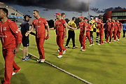Lancashire Lightning congratulate the losing Bears during the Vitality T20 Blast North Group match between Lancashire Lightning and Birmingham Bears at the Emirates, Old Trafford, Manchester, United Kingdom on 10 August 2018.