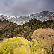 A spring snow storm covers the upper valleys with snow while the lower elevations stay brilliant spring green.