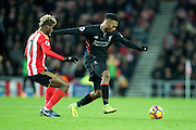 Liverpool forward Daniel Sturridge (#15) evades the challenge of Sunderland midfielder Didier Ndong (#17) during the Premier League match between Sunderland and Liverpool at the Stadium Of Light, Sunderland, England on 2 January 2017. Photo by Craig Doyle.