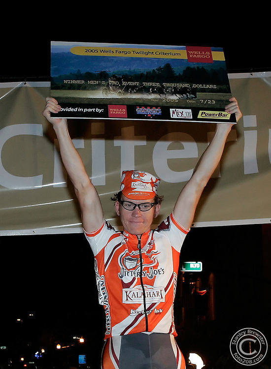 Boise, ID.  7-23-05   Australian Jeff Hopkins holds the 3000 dollar winner's check over his head after winning the mens pro race of the Ninteenth Twilight Criterium in downtown Boise.