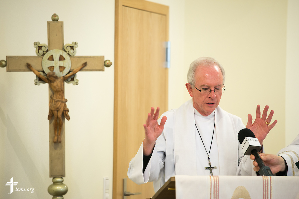 The Rev. David L. Mahsman, LCMS missionary and managing director of the International Lutheran Society of Wittenberg, blesses the pulpit during the dedication of The International Lutheran Center at the Old Latin School on Sunday, May 3, 2015, in Wittenberg, Germany. LCMS Communications/Erik M. Lunsford